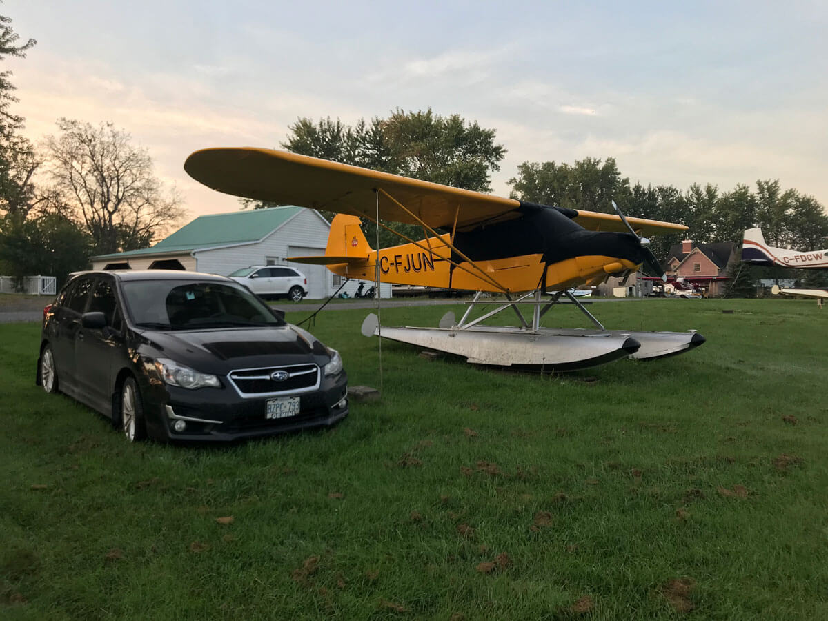 Car parked beside the plane