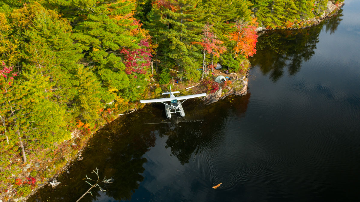 Unpacking Cessna 180 while fall camping