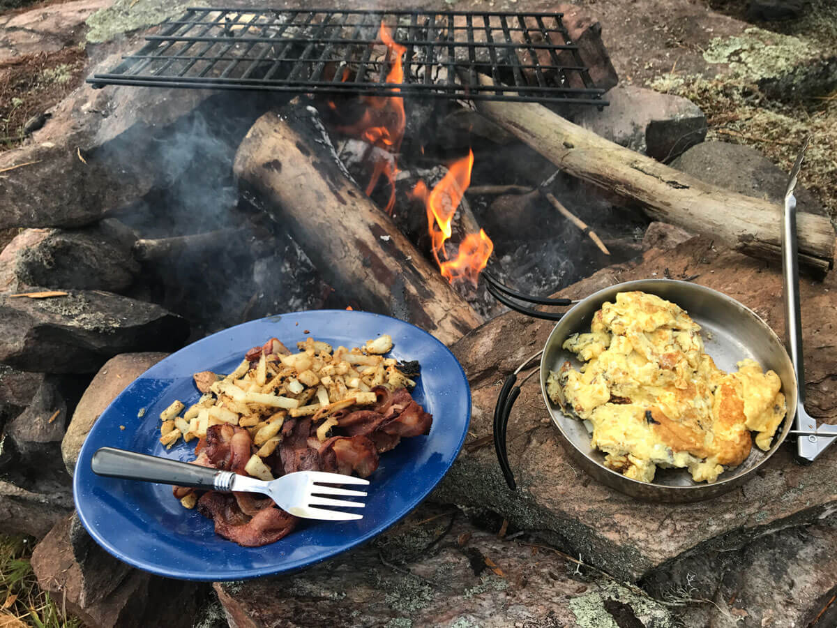 Bacon and Eggs cooked over campfire