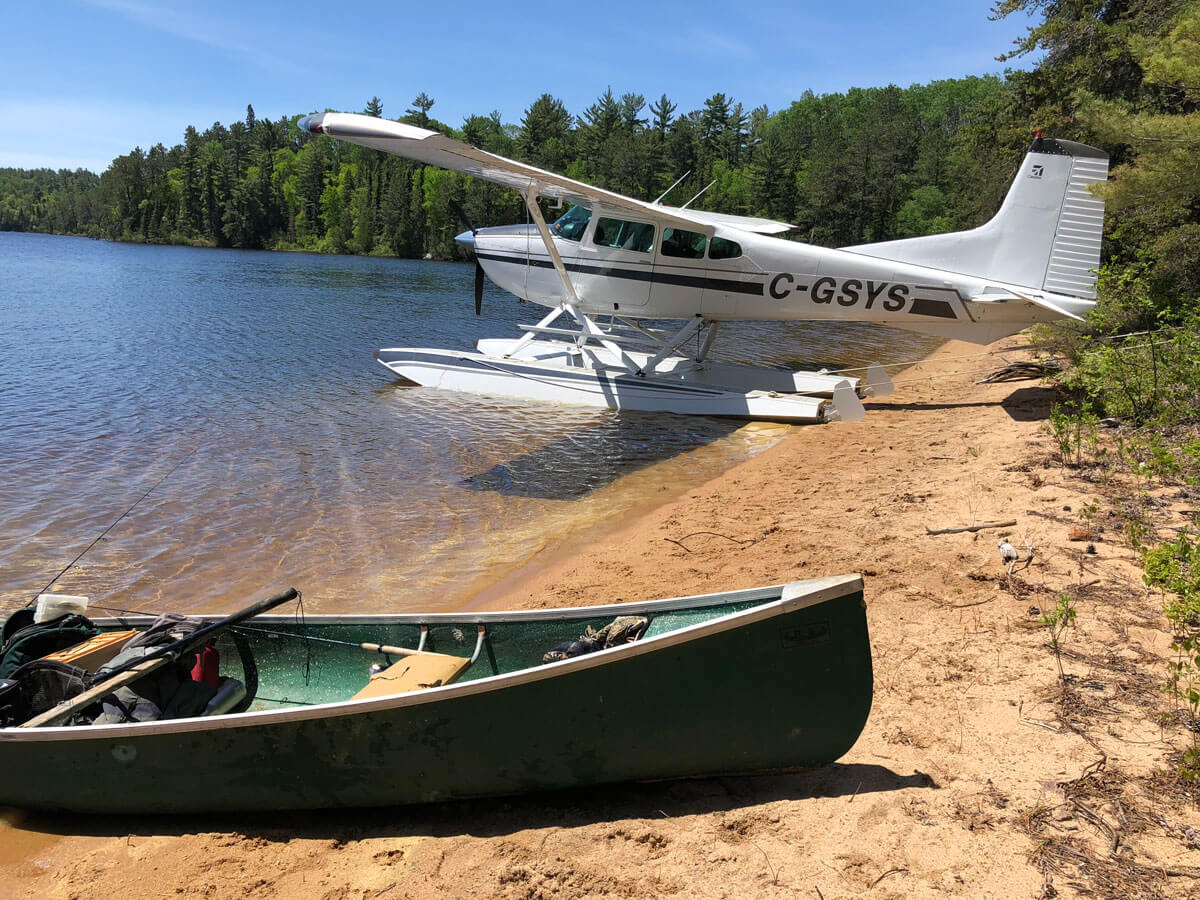 Cessna 180 and boat from bush ready to go fishing